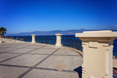Cast-iron banisters in Reggio Calabria. Cast-iron banisters in art-nouveau style in Reggio Calabria against Messina strait Royalty Free Stock Photography
