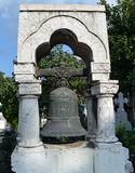 Cast-iron bell on grave in Bucharest cemetery, Romania Royalty Free Stock Image