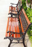 Cast iron benches. Cast iron and varnished wooden benches Stock Photography