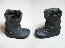 Cast-iron cast boots. Black color Royalty Free Stock Photo