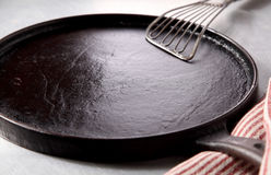 Cast Iron Burger Skillet and Spatula on Table Stock Photography