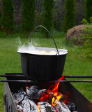 Cast iron cauldron over an open fire. Stock Image