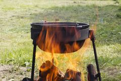 Cast-iron cauldron at the stake Stock Photography