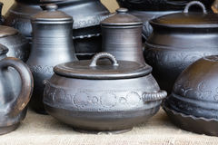 Cast iron cookware. On rough fabric Stock Photos