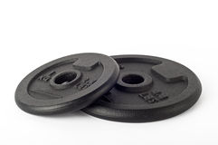 Cast iron discs. Two cast iron discs in black, are used to compose the handlebars to do weights Stock Photography