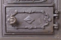 Cast iron door for furnaces. Fragment. Stock Photos