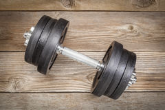 Cast iron dumbbell on wood Stock Images