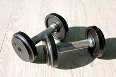 Cast iron dumbbells. On fitness floor Royalty Free Stock Photo