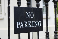 Cast Iron fence with a No Parking sign Stock Photo