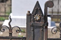 Cast Iron fence. Old cast iron fence with ornaments and blurry background Royalty Free Stock Photography