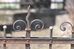 Cast Iron fence. Old cast iron fence with ornaments and blurry background Stock Photo