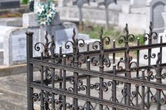 Cast Iron fence. Old cast iron fence with ornaments and blurry background Stock Photos