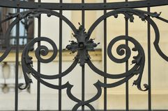 Cast Iron fence. Old cast iron fence with ornaments and blurry background Royalty Free Stock Photos