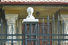 Cast Iron fence. Old cast iron fence with ornaments and blurry background Stock Photography