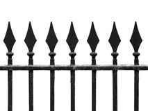 Cast iron fence with spears isolated on white. Old cast iron fence with spears isolated on white. Seamless fragment stock photos
