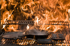 Cast Iron Flames. This image of some cast iron cookware being prepared for use Stock Images