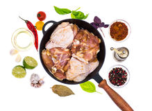 Cast-iron frying pan with marinated chicken thighs for frying Royalty Free Stock Photography