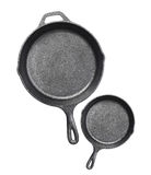 Cast iron frying pans Isolated on white Royalty Free Stock Photography