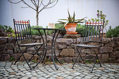 Cast iron garden furniture on a patio Stock Images