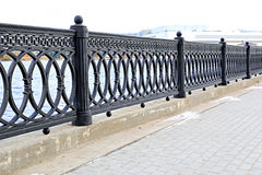 Cast iron grate fence on the embankment Royalty Free Stock Photography