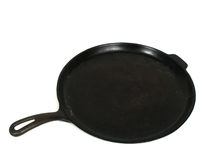 Cast Iron Griddle. On a white background Royalty Free Stock Images