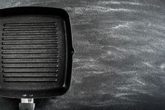 Cast iron griddle. Pan on black background Stock Image