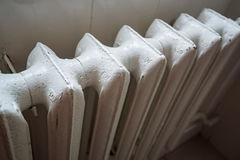 Cast iron household radiator close up Stock Images