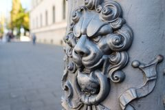 Cast iron lion head with ornamentation in munich. Cast iron lion head with ornamentation painted with rust protection paint in munich royalty free stock images