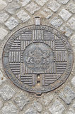 Cast iron ornamented manhole cover in Budapest, Hungary. Stock Images