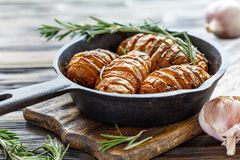 Potatoes baked with garlic and rosemary. Royalty Free Stock Image