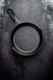 Cast iron pan on black metal culinary background Stock Photography