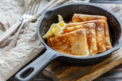 Crepes with butter and powdered sugar. Royalty Free Stock Photos