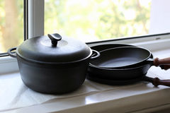 Cast iron pans Stock Photos