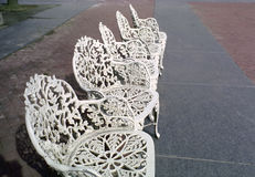 Cast Iron Patio Chairs, New York USA. Vintage cast iron chairs wait for visitors to Liberty Island, New Jersey stock images