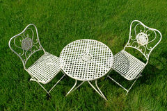 Cast Iron Patio Furniture Set on Green Grass stock photos