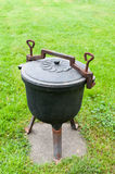 Cast iron pot. Iron kettle for stewed dishes royalty free stock images