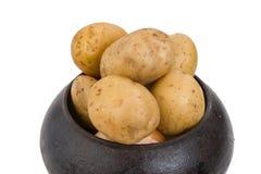 Cast iron pot with a potato Stock Photography