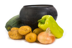 Cast iron pot and vegetables Stock Photo