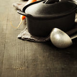 Cast iron pot and vegetables royalty free stock photography