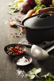 Cast iron pot and vegetables royalty free stock photos