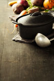 Cast iron pot and vegetables stock image