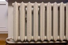 Cast iron radiator for water heating stock photos