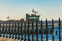 Cast iron railings at Circular Quay and ferry on the background. Selective focus on railings. Sydney, Australia Stock Image