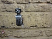 Cast iron shutter keeper on a yellow brick wall. In Ghendt Belgium royalty free stock photo