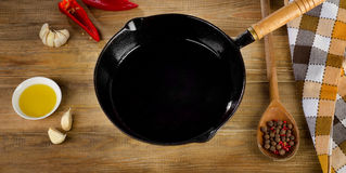 Cast iron skillet on a rustic wooden table. Stock Image