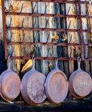 Cast iron skillets on a rusty rack Stock Image