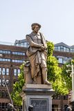 The cast iron statue of Rembrandt at the Rembrandtplein Rembrandt Square. Amsterdam, Netherlands - May 21, 2018: The cast iron statue of Rembrandt at the royalty free stock photo