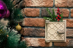 Cast iron stove door decorated with Christmas toys Royalty Free Stock Photos