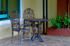 Cast iron table and chairs in the garden Stock Images