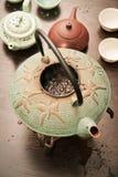 Cast iron teapot boiling puer tea stock photo